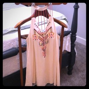 Boho style, casual dress with super cute back.